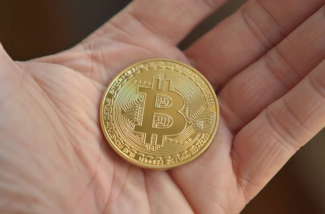 Golden Coin BTC in the hand