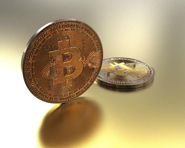 Moneta d'oro BTC - due monete
